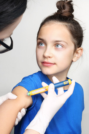 insulin syringe: The injection of insulin, a child with diabetes Stock Photo