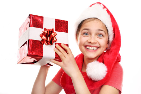 happynes: Happy child in the cap of St. Nicholas of packaged gift Stock Photo