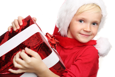 happynes: We make dreams come true. Happy child with Christmas gift. Stock Photo