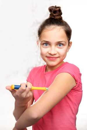 Girl with diabetes during the injections of insulin.