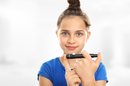 blood sugar: Blood sugar testing, child finger lancet punctures Stock Photo