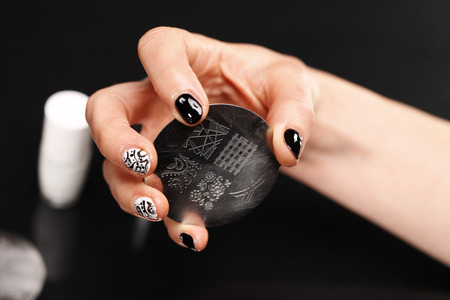 nail lacquer: Stamps Applies the beautician nail lacquer on plaque