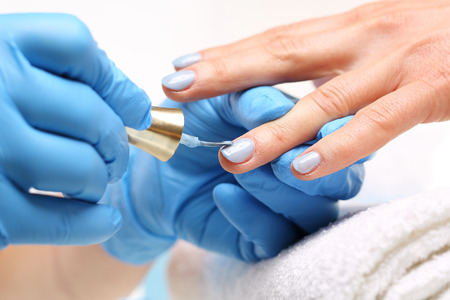 nail bar: Blue manicure. Styling nail color nail polish Stock Photo