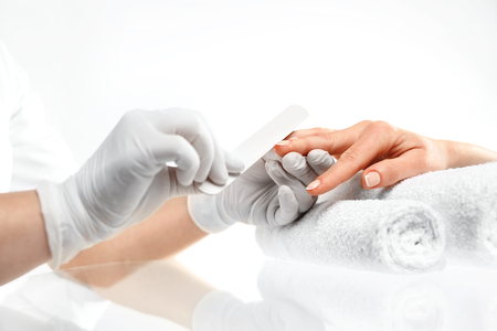 beauty parlor: Sawing nails, manicure.