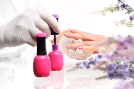 nail bar: Pink manicure. Colored manicure, cosmetic colored lacquer painting nails Stock Photo