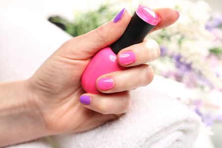 Pastel nails, purple nail polish. Colored manicure, cosmetic colored lacquer painting nails