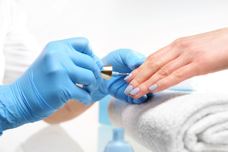 cosmetic lacquer: A beauty salon, a colorful manicure. Colored manicure, cosmetic colored lacquer painting nails