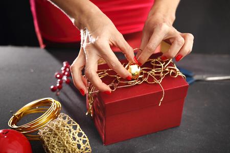 tree works: Woman Christmas gift packs Stock Photo