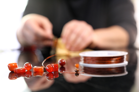 manufactory: Manufactory, a woman carries jewelry made of amber Stock Photo