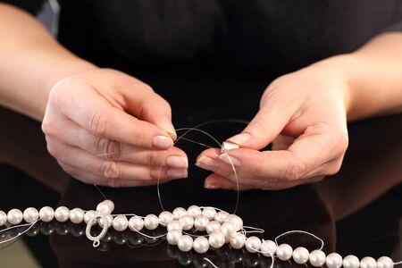 threading: Threading beads. Pearl beads