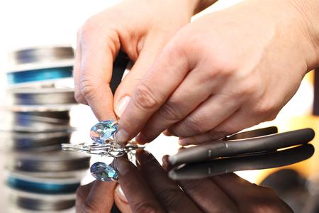 swarovski: Woman performs necklace with Swarovski crystals