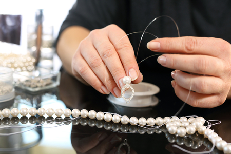 pearl necklace: Jeweler and a pearl necklace