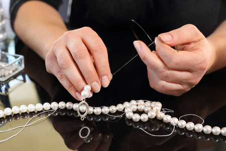 pearl necklace: Pearl earrings and jewelry jeweler Creates Stock Photo