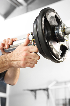 free weights: Barbell, the coach does load. Equipment gym equipment dumbbell, barbell weights