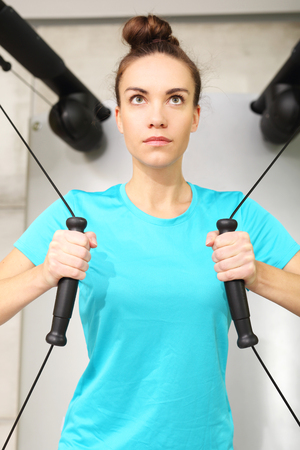 stretching condition: Woman trains in the gym
