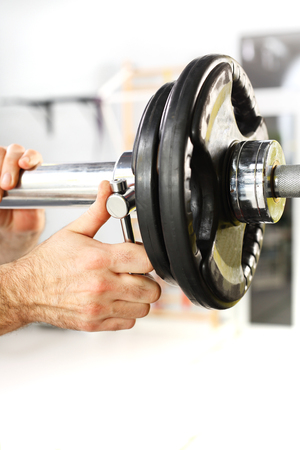 free weights: Trainer in the gym, training with weights Stock Photo