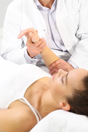 traumatology: Doctor and patient. The doctor holds the patients hand