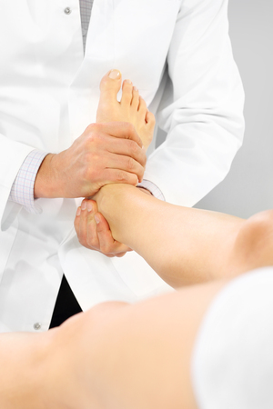 orthopedic: Orthopedic surgeon examines the patients foot