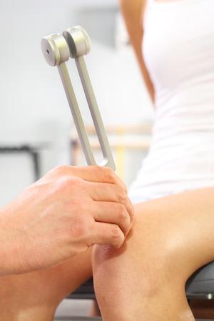 tuning fork: Orthopaedist, tuning fork, orthopedic examination Stock Photo