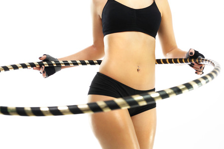 flesh: The woman is training your abdominal muscles by turning the wheel hula hoops.