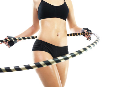 flat stomach: Circle hula hoops, and the way to a flat stomach.