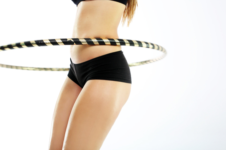 flat stomach: A flat stomach and companies buttocks, the woman trains with wheel Hula Hop.