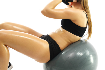 flat stomach: Flat stomach exercises on the ball Stock Photo