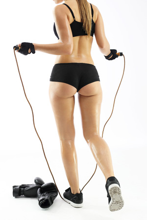 Jump rope, exercise to slim. Athletic woman jumping rope Stock Photo