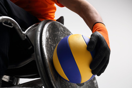 paralysis: Sport in a wheelchair. The man on the sports wheelchair with the ball
