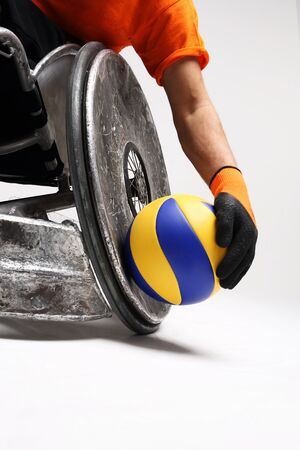 disabled sports: Paralympics. The man on the sports wheelchair with the ball
