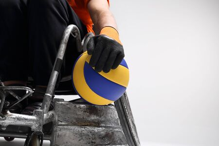 disabled sports: Disabled wheelchair. The man on the sports wheelchair with the ball