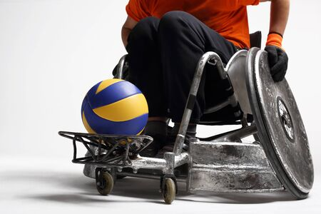 paralysis: Disability. The man on the sports wheelchair with the ball