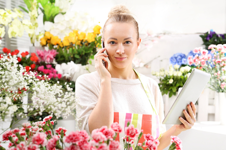 accepts: Flower Accepts telephone order for a bouquet Stock Photo