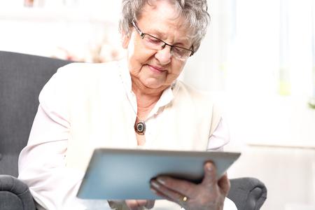 70 80 years: Grandma and computer. Stock Photo