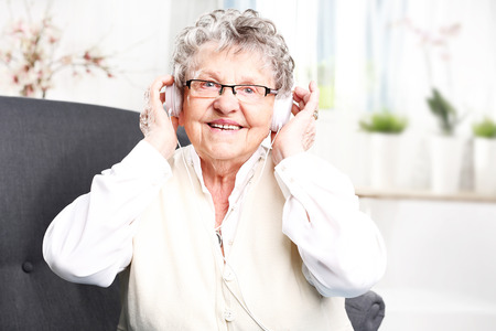 the great grandmother: A moment of relaxation, rest grandmother listening to music.