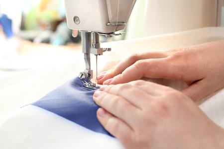 presser: Sewing on a machine.