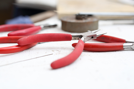 tongs: Tongs and pliers, workshop tools Stock Photo