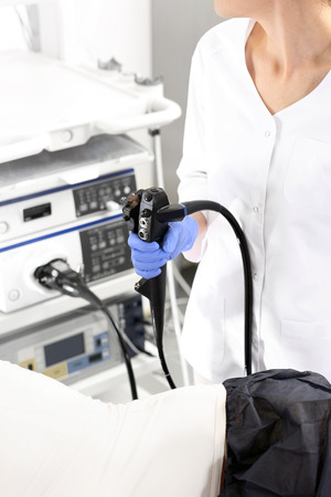 doctor examine: Hospital ward, gastroenterologist preparing the study.