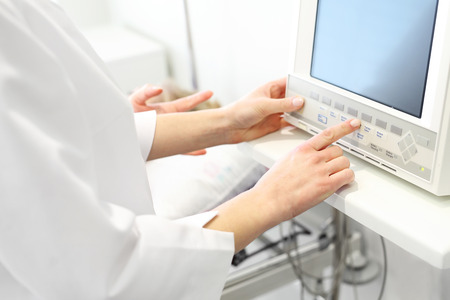 anesthesiologist: Anesthesiologist connected heart monitor.
