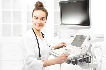 sonogram: Ultrasound. The doctor, sonogram examination Foto de archivo