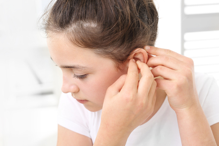 hearing aid: Hearing aid for your child Stock Photo