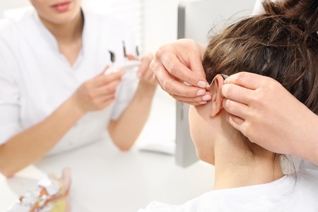 Hearing: Hearing loss in children. A child at the ENT doctor. Stock Photo