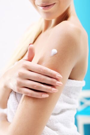 Body care in the shower. The woman rubbed into the skin lotion Stock Photo