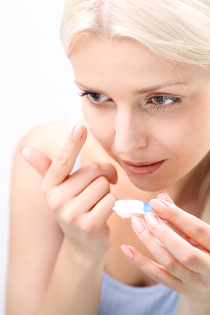 Contact lenses. woman assumes contact lenses. Stock Photo