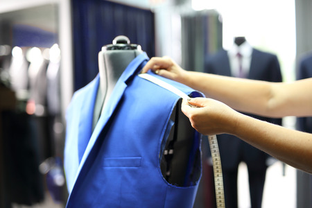 Men seamstress, a suit made to measure. The production plant, sewing jackets for seamstress