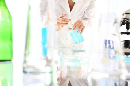 bureta: Engineering. Chemist working in scientific laboratory Foto de archivo