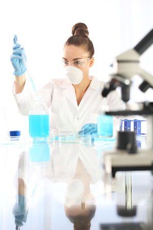 analytical chemistry: Research. Chemist examine the samples under a microscope. Stock Photo