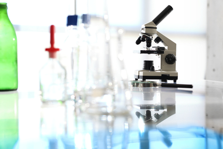 analytical chemistry: Microscope. Workshop laboratory microscope stands on a glass countertop