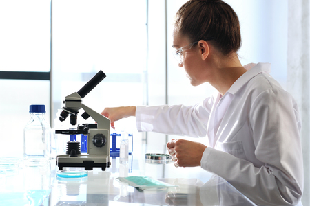 analytical chemistry: Biotechnologist examine the plant samples in the laboratory