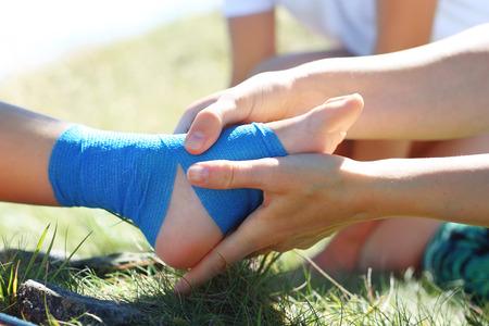 Bandaging feet.